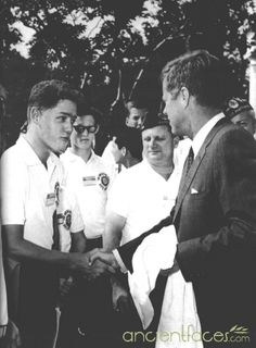 A young Bill Clinton shaking hands with President John F. Kennedy on July 24th, 1963. Who would have thought back in 1963 that this photo would contain two United States Presidents?
