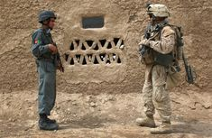 Marine and an Afghan national policeman pause while on a joint patrol March 2009 near Bakwa in southwestern Afghanistan. Afghanistan War, Military Love, Insurgent, American Soldiers, One Team, Barack Obama, Troops, Cambodia, Marines
