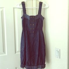 Dress Brand new/ never worn.  Dress looks like jean material but it's not.  It's 100% cotton. Mine Dresses