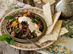 Sometimes you just feel like a grainy something and this wild rice and lentil salad does it. Simple but substantial, its exotic flavours and textures make a great meal, or serve it as a swanky side.