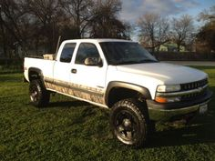 I miss my baby... Shouldn't have sold this one. Lifted Chevy Silverado with camo accents and rockstars.