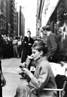 """oldhollywoodfilms: """"Audrey Hepburn gets ready to film a scene from Breakfast at Tiffany's (1961) in New York City while a large crowd watches. """""""