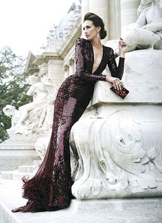 Deep maroon,  sequined gown with a plunging neckline
