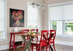Create an American Farmhouse Chic style with a simple trestle table, painted red chairs and Duette® Architella® honeycomb shades. ♦ Hunter Douglas window treatments #DiningRoom