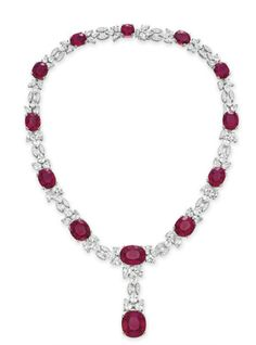 A RUBELLITE TOURMALINE DIAMOND AND COLORLESS SAPPHIRE NECKLACE