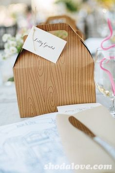 Paper boxes with wood designs for the wedding favors - so cute! #wedding #weddingfavors #diywedding #woodland #rustic
