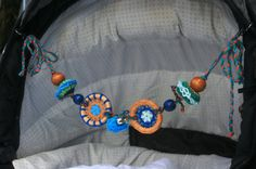 Colourful crocheted baby pram or cot rattle