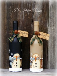 This Primitive Snowman Wine Bottle ~ Snowman Decor ~ Christmas Decor ~ Winter Decor ~ Snowmen ~ Christmas Gift ~ Painted Wine Bottle is just one of the custom, handmade pieces you'll find in our ornaments & accents shops.These mauve container designs Liquor Bottle Crafts, Recycled Wine Bottles, Wine Bottle Art, Painted Wine Bottles, Lighted Wine Bottles, Beer Bottle, Decorated Bottles, Bottle Labels, Glass Bottle