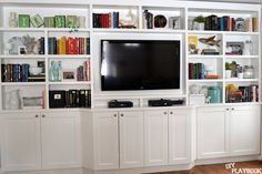 White built in bookshelves with colorful books and accessories