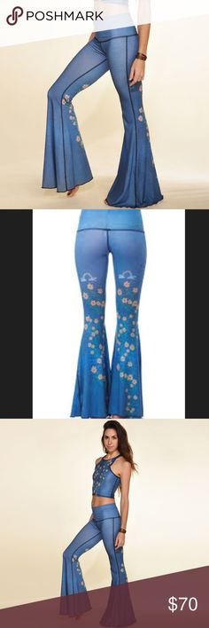 Teeki Woodstock Bellbottoms So cute. Worn once. No flaws. I keep trying to be a colorful pants person but I just don't think I am. I just don't wear them that much. Very flattering. Blue with rainbow and flower design on the back. teeki Pants Leggings
