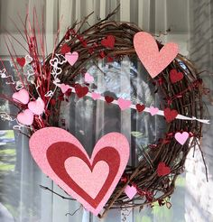 Valentine's Wreath:  Michael's Grape Vine Wreath and Spray, Dollar Tree hearts and picks. (Super Cheap and Cute!!)