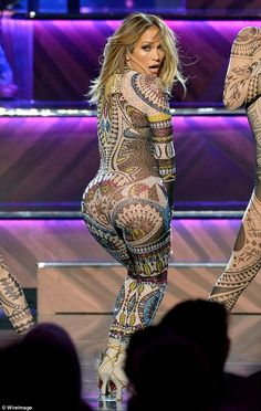 Flaunt it: Jennifer Lopez got the show off to a sizzling start in a patterned catsuit that showed off every inch of her famous figure