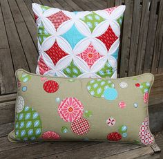 Love the colors of the cathedral window pillow.  Such happy colors!