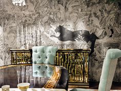 Patel green dining chairs against modern panther patterned wallpaper - The beautiful Italian furniture designs of Provasi, combining traditional and contemporary style to produce iconic works or art. Showcasing at Salon del Mobile, Milan