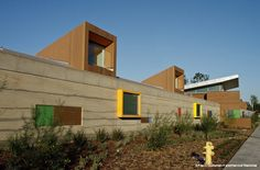 Located in Glendale, California, the 23,000 square-foot childcare facility, designed by Marmol Drainer, accommodates 236 children between infant and Pre-K ages. The complex is the first LEED Gold Certified building in Glendale, and is the largest rammed earth building in Southern California.