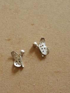 Off for a little flight - Mythika ear studs in the making. Mythika handmade silver jewelry by Priya Jhavar
