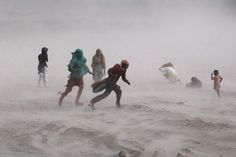 STIRRING UP: People tried to walk amid a storm near the Ravi River in Lahore, Pakistan, Sunday. Heavy rains lashed the capital. (Arif Ali/Ag...