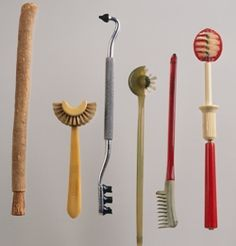 Toothbrushes through the ages  -----    Painful.  Some of these look excruciating.