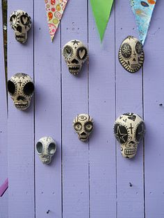 Wall of Clay Skulls Leanne Pizio Allie, I have the one with the third eye!
