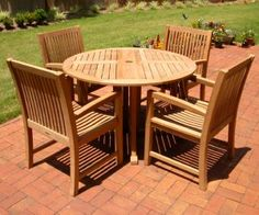 """Savannah Drop Leaf Table (Seats 4):   Both sides of this teak table fold down and the legs swing in to allow for easy movement and storage. Notice the """"extra thick"""" legs on this table. This is one of our most popular items! Dimensions: 48"""" Diameter x 30""""H **Chairs sold separately**"""