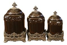 Drake Design 3555 Large Canister (3-Piece Set), Coffee, 13.5,12,10 Inch by Drake Design. $180.00. Hand crafted ceramic canisters; die-cast resin bases and resin fleur de lis on lids. 3-pc large canister set individual sizes are 8x13.5x8 7x12x7 and 6.25x10x6.25. Ceramic body is oven-safe; microwave-safe; dishwasher-safe; food-safe; air tight removable lids; removable bases. This handsome yet decorative 3 piece large, handcrafted, ceramic canister set adds functionality and ...