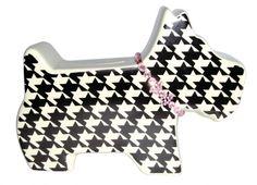 SALVADANAIO CANE. Salvadanaio in resina a forma di cane di colore bianco e nero