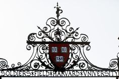 Harvard's seal atop a gate to the athletic fields at Harvard University in Cambridge.