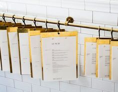 Menus hanging as you walk in? Out in lobby by couches?