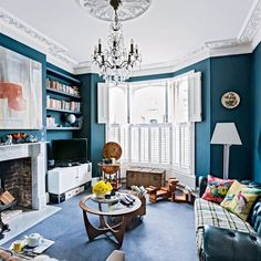 Cosy eclectic London living room teal walls see to make the pretty moulding stand out. They just need to bring the furniture off the walls and into the room a bit more. Chandelier not low enough for me. Teal Living Rooms, Home And Living, Living Room Decor, Living Spaces, Living Area, Peacock Living Room, Interior Flat, Home Interior, Interior Design