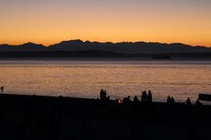 Alki Beach, Seattle. This is on my college bucket list. To see the sunset at Alki Beach. Can you have a fire there? That's my dream!