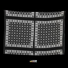 A black and white printed cloth of the Comoro islands. It is designed with repeating square panels, each with a continuous patterned border of geometric floral motifs in black on a white background, enclosing a central design of the same motifs, but in white on a black background. The cloth has been sewn together into a tube to form the lower part of a Comorean woman's dress.