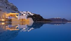 Mystique Hotel in Santorini, Greece, on Oia's famous cliffs  --  Between The Boxwoods