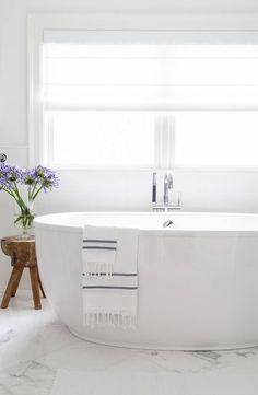 Marble bathroom floors, modern free standing tub and raw wood side table. Marble Bathroom Floor, Bathroom Flooring, Modern Bathroom, Concrete Bathroom, Marble Floor, Minimalist Bathroom, Bathroom Faucets, Small Bathroom, Wood Tub