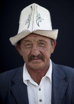 Old Man Wearing A Kalpak Hat in Kochkor, Kyrgyzstan