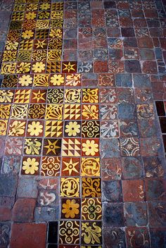Winchester Cathedral. Medieval floor tiles have been patched using modern copies.