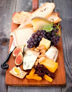 Snack Platter  plates of nuts, olives, fresh vegetables, and cheese straws placed throughout your home.