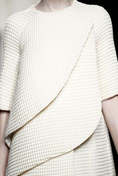 Cream coat with curved lines, layers & micro textures; chic fashion details // Amaya Arzuaga F/W 2015