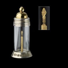 A microscopic carved sculpture of a nude female by Willard Wigan, standing with crossed hands, within glass case with silver-gilt mounts. Hallmarked Birmingham 2003. Total height including case measuring 3.9 cm.Willard Wigan MBE, was born in Birmingham, England in 1957. Wigan`s microscopic art is typically placed in the eye of a needle or on the head of a pin; some of his more famous pieces include a minute reproduction of Michelangelo`s David, carved out of a single grain of sand.