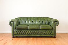 Hey, I found this really awesome Etsy listing at http://www.etsy.com/listing/159549085/vintage-green-leather-chesterfield-sofa