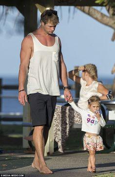 Hand-in-hand: The actor and his daughter looked very content as they walked barefoot through the park