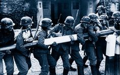 German troops tear down border posts as they advance into Poland, 1939. Pinned from germanwarmachine.com