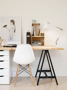 Fresh-looking sawhorse table for a clean, non-stuffy, and affordable workspace.