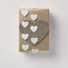 gift wrapping with paper hearts garland