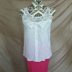 White Bow Mesh Top Gorgeous little top! White mesh upper with Keyhole back. The bottom is a light, flowy cotton. Adorned with a cute little bow on the front. Size Small. New without tags. Skirt available in another listing Ambiance Apparel Tops Blouses
