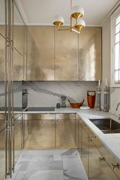 Would You Dare? Glamorous Gold Kitchen Cabinets & Islands