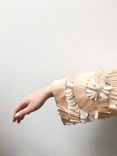 Softly structured - ArtsThread Fabric Manipulation - pleated sleeve detail exploring repeating patterns in organic form;