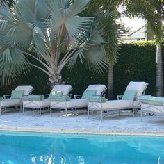 FORUM Double Chaise Lounge with Adjustable Canopy FM 2895-46LWC | Chaise Lounge with Wheels FM 2890LW | Dining Side Chair FM 2020L | Umbrella Table FM 2000 Series (Lyons Monahan Home Miami Beach)