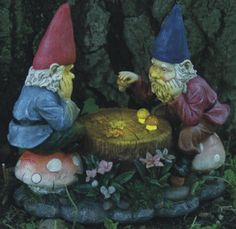 gnomes playing with solar checkers I got these guys ...they are smaller than I thought they would be but I really like them.