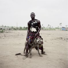 "Pieter Hugo - The Hyena & other men:   ""The Dog's master""."