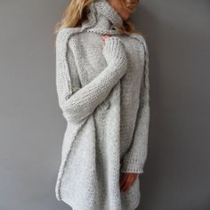 This cozy sweater is ideal for layering, with a soft drape and flattering roll-over collar. We think its an easy pick for your new favorite on cool weather days. The Specs: Style: Pullover Fabric: Kni